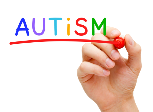 Hand writing Autism with marker